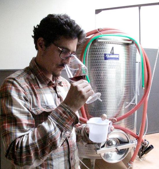 Pierre Jean nosing wine in Casa Raia's cantina