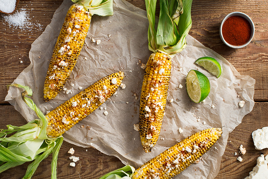 Grilled Corn in the Husk with Cotija Cheese & Lime