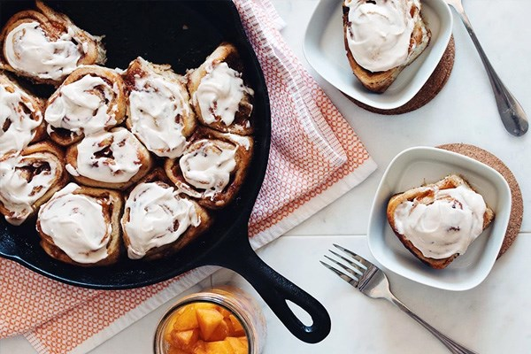 Vegan Cinnamon Rolls with Spiced Whiskey Peaches