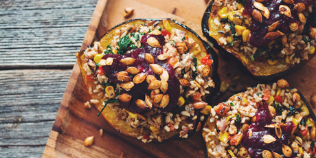Stuffed Acorn Squash with Red Wine Cranberry Sauce
