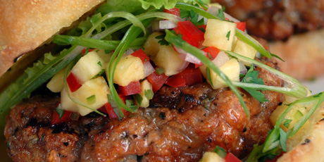 Moist and delicious turkey burgers topped with fresh and flavourful ...