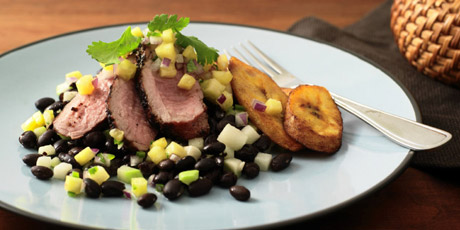 Jerk Pork Tenderloin with Chayote Black Beans, Pineapple Salsa and Fried Plantains
