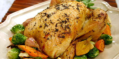 Roasted chicken with lemon and herbs recipes food network canada roasted chicken with lemon and herbs forumfinder Image collections