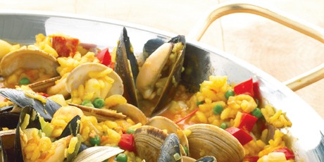 Seafood and sausage paella recipes food network canada seafood and sausage paella forumfinder Image collections