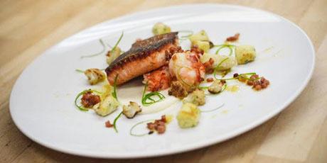 Crispy Skin Steelhead with Poached Lobster, Braised Endive, Cauliflower and Speck Vinaigrette