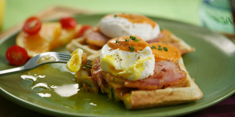 Eggs Benedict with Peameal Bacon on Scallion Waffles and Tomato Cream