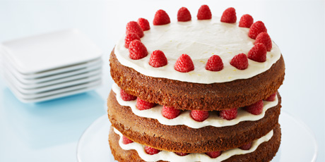 Elegant Gingerbread Layer Cake with Raspberries and Lemon Buttercream Frosting