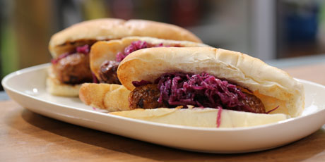 Beer Glazed Grilled Bratwurst with Wilted Red Cabbage Slaw