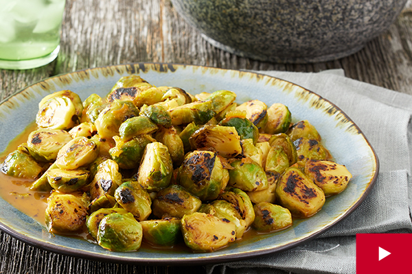 How to Pan Roast Brussels Sprouts With an Orange and Sriracha Glaze